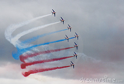 Eight airplanes with color smoke make turn on clou