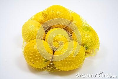 Eight fresh lemons in a bag