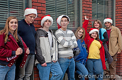 Eight Teens Leaning against Brick Building