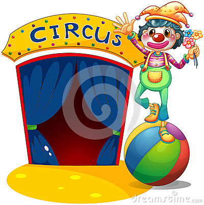 Ein Clown, der über dem Luftball balanciert