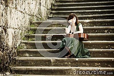 Ejecutante joven de la guitarra