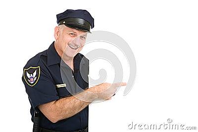 El señalar feliz del policía