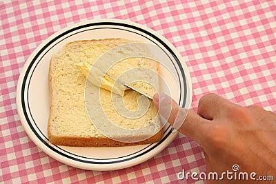 El untar con mantequilla im genes de archivo libres de for Cuchillo de untar mantequilla