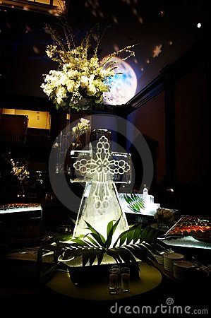 Elaborate ice sculpture at a wedding reception