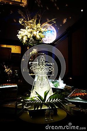 Elaborate ice sculpture at a wedding reception