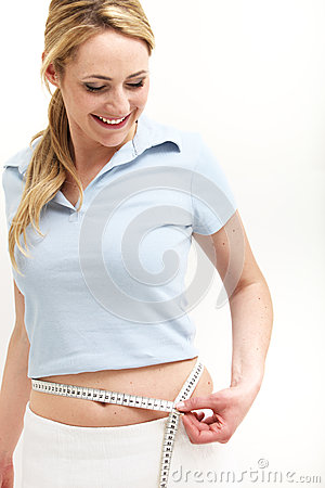 Elated woman measuring her waist