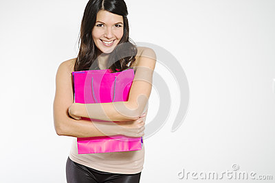 Elated young woman clutching her purchases