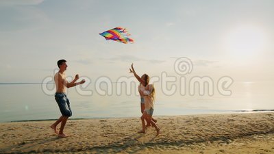 The Elder Brother is Playing with His Younger Sisters. Running with a Kite, Girls are Catching Up with Him. a Happy Stock Footage - Video of color, playing: 82384748