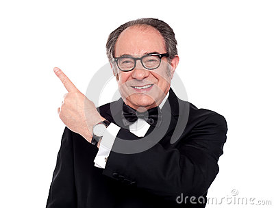 Elder man pointing upwards. Copy space area