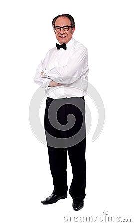 Elder man posing with arms crossed