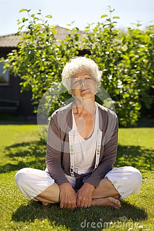 Elder woman enjoying fresh air in garden