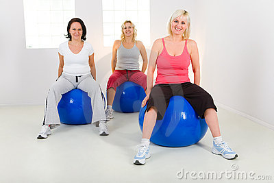 Elder women exercising on fitness balls