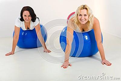 Elder women exercising on fitness balls
