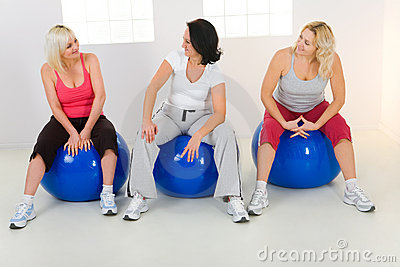 Elder women sitting on fitness balls