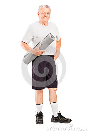 Elderly athlete holding a mat