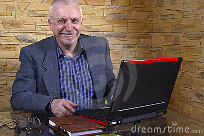 Elderly business man on laptop