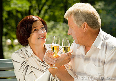 Elderly couple celebrating