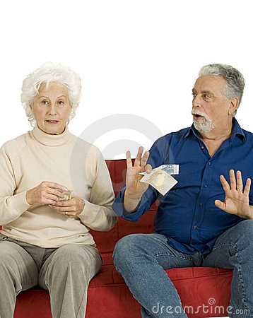 Elderly couple on the couch with money in hand