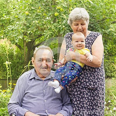 Elderly couple with granddaughter