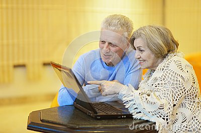Elderly couple with laptop