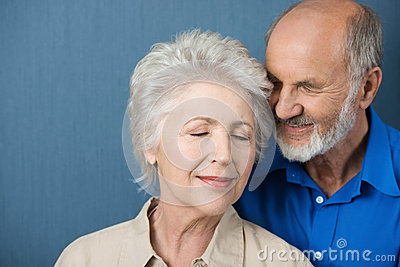 Elderly couple share a tender moment