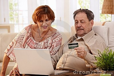 Elderly couple shopping online
