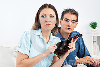 Elderly couple showing empty wallet