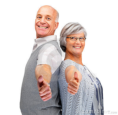 Elderly couple showing thumbs up sign together