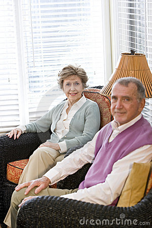 Elderly couple sitting on living room couch