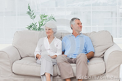 Elderly couple sitting on sofa