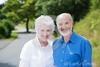 Elderly couple standing in a rural road