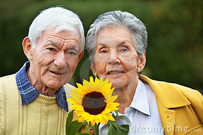 Elderly couple with a sunflower