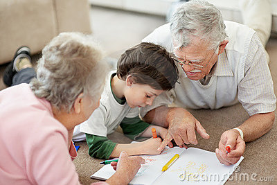Elderly couple with their grandson