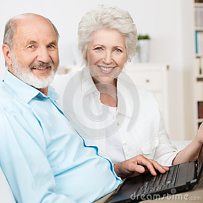Elderly couple using a laptop computer