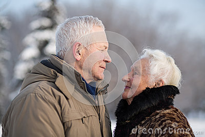 Elderly couple in winter park