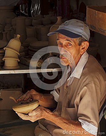 Free Elderly Cuban Gentleman In Pottery Factory Stock Images - 66594834
