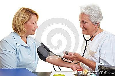 Elderly doctor with blood pressure