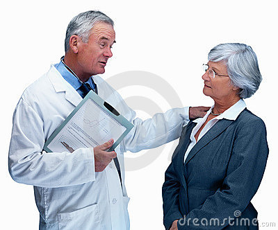 Elderly doctor consulting a client on white