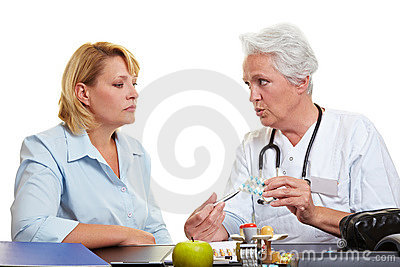 Elderly doctor offering medication