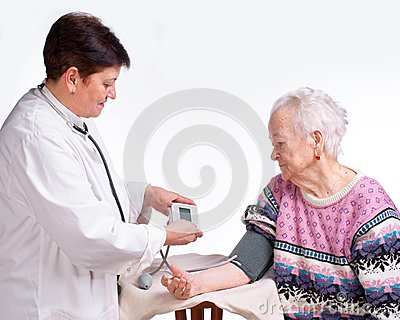 Elderly doctor and patient. Measuring pressure.
