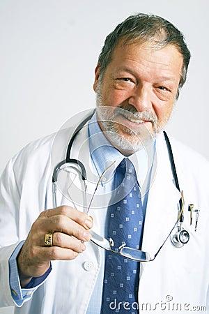 Elderly doctor smiling