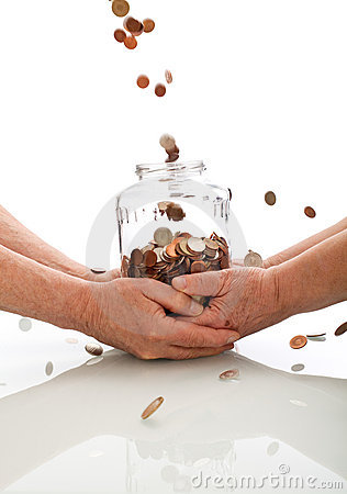 Elderly hands holding jar catching falling coins