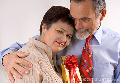 Elderly happy couple with gift