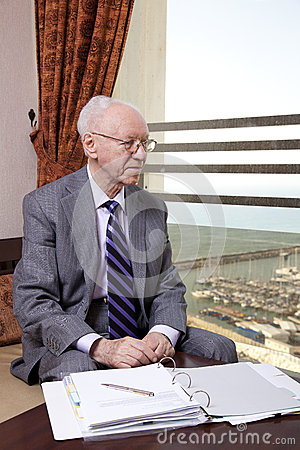 Senior Businessman Looking Out the Window