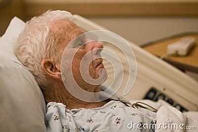 Elderly hospital patient sleeping