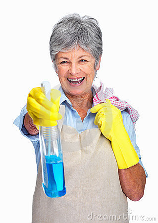 Elderly housewife spraying the cleaner on you