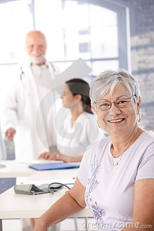 Elderly lady at health control smiling
