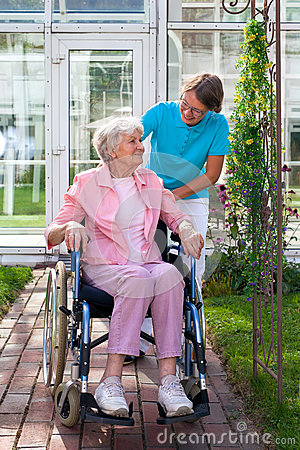 Free Elderly Lady In A Wheelchair With Her Carer. Royalty Free Stock Image - 44681336