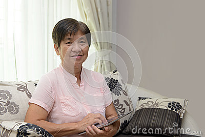 Elderly lady with notepad