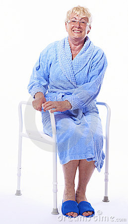 Elderly lady on shower seat